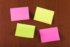 Sticky papers. On wood background Royalty Free Stock Photos