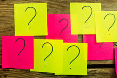 Sticky papers with question marks Stock Photos