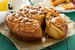 Sticky pecan buns on breakfast table Royalty Free Stock Photography