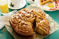 Sticky pecan buns on breakfast table Stock Images