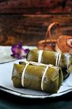 Sticky Rice with Banana Filling on Dish royalty free stock photo