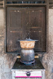 Sticky rice being cooked in dirty old kitchen. Thailand style Stock Photo