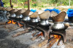 Sticky rice cooking in earthen streamer Royalty Free Stock Image