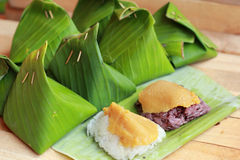 Sticky rice with custard wrapped in banana leaves. Stock Photos