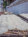 Sticky rice drying in the sun. Luang Phabang, Laos, Asia stock photography