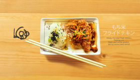 Sticky rice and fried chicken and bamboo chopstick on wood Stock Photos