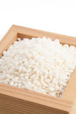 Sticky rice in Japanese sake cup called Masu Royalty Free Stock Image