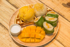 A sticky rice mango with ice cream and waffle in warm light Royalty Free Stock Photography