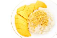 Sticky rice with mango and sesame. Sticky rice with mango and sesame on plate royalty free stock photography
