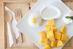 Sticky Rice with Mango on wood background Royalty Free Stock Images