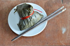 Sticky rice steam with pork and salt egg in banana leaf of Chinese Duanwu festival Royalty Free Stock Images