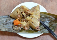 Sticky rice steam with pork and salt egg in banana leaf of Chinese Duanwu festival Stock Images