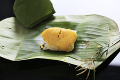 Sticky rice with steamed custard, wrapped in banana leaves,Thai. Dessert Stock Photo