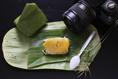 Sticky rice with steamed custard, wrapped in banana leaves,Thai Stock Photos