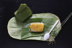 Sticky rice with steamed custard, wrapped in banana leaves,Thai Stock Image