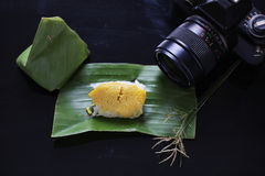 Sticky rice with steamed custard, wrapped in banana leaves,Thai Royalty Free Stock Photography