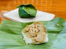 Sticky rice Thai custard on green banana leaf Royalty Free Stock Image