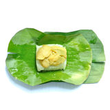 Sticky rice topped egg custard in banana leaf Stock Photos