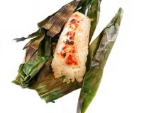 Sticky rice. Wrapped in banana leaves stock image