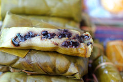 Sticky rice wrapped in banana leaves - dessert Thailand. Stock Photos