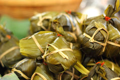 Sticky rice wrapped in banana leaves - dessert Thailand. Stock Photo