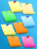 Sticky squares of different colors with pins Stock Image