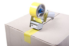 Sticky tape. Sticking a paper box by yellow tape Stock Photo