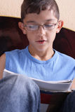 Stident. Relaxed young man reading a book Stock Photo