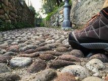 Stiefel auf der Spur Stockbild
