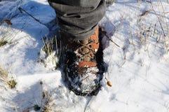 Stiefel im Schnee Stockfotos