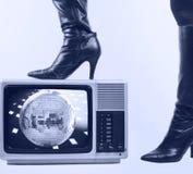 Stiefel und Fernsehen stockfoto