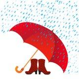 Stiefel unter einem Regenschirm und einem Regen Stockfotos