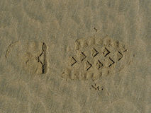 Stiefeldruck im Sand Stockbild