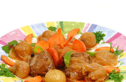 Stifado dish Greek recipe. Fresh meat cooked with onions Stock Image