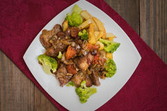 Stifado - a traditional Cypriot dishes, spread in Greece. It consists of  stew with tomatoes, potatoes, broccoli, onions Royalty Free Stock Photography