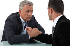 Stiff competition. Between two salesmen Royalty Free Stock Images