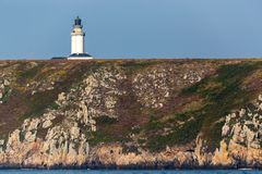 The Stiff lighthouse on the cliff top Royalty Free Stock Photography