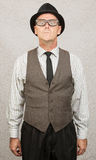 Stiff Man Standing. Scared stiff businessman with hat and eyeglasses Stock Photos