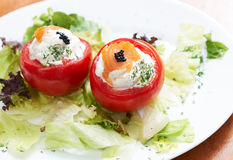 Stiffed tomatoes with salmon Royalty Free Stock Photography