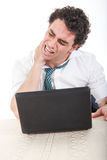 Stiffness, back pain and neck pain because overtime at work Stock Images