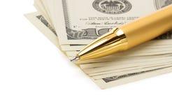 Stift auf Dollargeldbanknoten Stockfotos