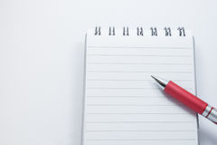Stift auf Notizblock Stockbild