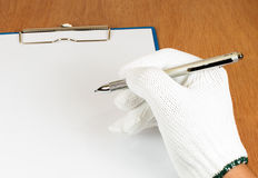 Stift in der Arbeitskraft 's-Hand Stockbild