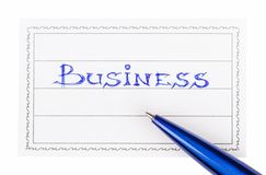 Stift und Ausweis mit dem Aufschriftgeschäft Stockfotografie