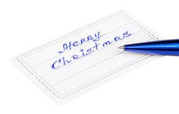Stift und Ausweis mit den Aufschrift frohen Weihnachten Lizenzfreie Stockfotos