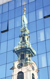 Stiftskirche in reflections of high glass building Stock Photos