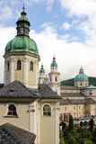 Stiftskirche Saint Peter and Cathedral. Salzburg. Austria. Saint Peter church dome at the foreground and towers and dome of the Cathedral. Salzburg. Austria royalty free stock photos