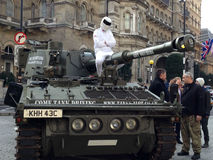The Stig protesting at BBC. LONDON, UK - MARCH 20, 2015:  The Stig on a tank at  BBC Broadcasting House after delivering a petition supporting Jeremy Clarkson Royalty Free Stock Images
