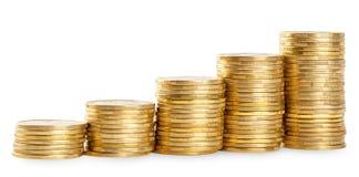 Stigande kolonner av guld- mynt Fotografering för Bildbyråer
