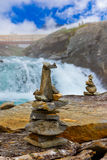 Stigfossen waterfall and stones stack - Norway Royalty Free Stock Photos